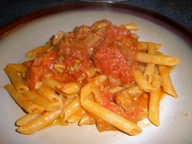I added an extra ladle of sauce on top.  Notice how the sauce that was finished in the pot with the pasta is lighter in color and is coats the noodles.  No naked noodles here, folks.